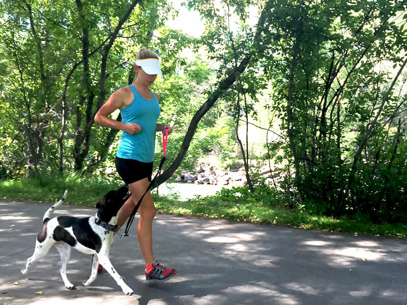 Running with dog in heel position